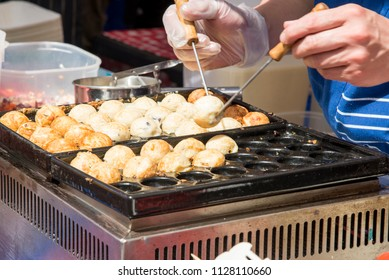 Korean chef cooking rice balls on Food Street Festival - Food Street Market Reading, United Kingdom