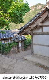 Korean Confucian Academy from Joseon Dynasty era. View of eastern dormitory with traditional gate and stewards house behind. Byeongsan Seowon, Andong, South Korea.