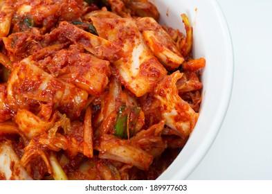 Korean cuisine, fermented food Kimchi on white ceramic bowl