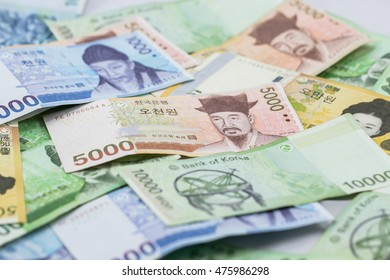 Korean currency.South Korean Won Currency.Pile of various currencies isolated on white background.