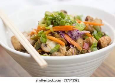 Korean Dak Bulgogi chicken rice bowl topped with fresh scallions