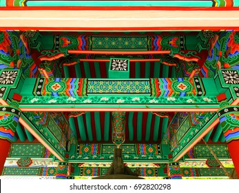 Korean 'Dancheong' in temple. Dancheong refers to the use of five colors of blue, red, yellow, white, and black as the basis for drawing various multicolored patterns and drawings on wooden buildings.