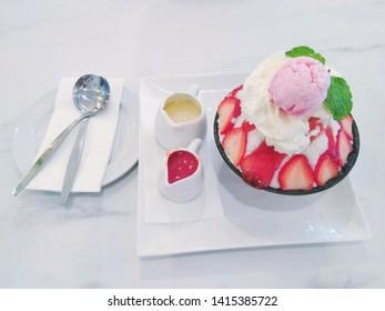 Korean dessert, Bingsoo or Bingsu,Korean shaved ice dessert with sweet toppings. Strawberry Bingsoo or Bingsu.