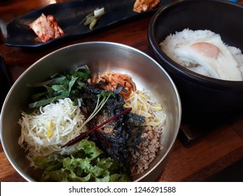 Korean dish Bibimbap with side dishes Bibimbap is boiled rice with assorted mixtures of meats and vegetables