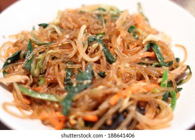 Korean dish known as Japchae made from sweet potato noodles, stir fried in sesame oil with various vegetables.