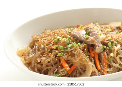 Korean dish known as Japchae made from sweet potato noodles, stir fried in sesame oil with various vegetables