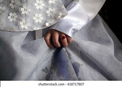Korean female wearing white traditional dress