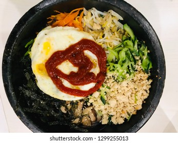 Korean food / Bibimbap is served as a bowl of warm white rice topped with namul and gochujang, soy sauce, or doenjang