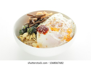Korean food, Bibimbap vegetable and egg on rice with chili pepper sauce