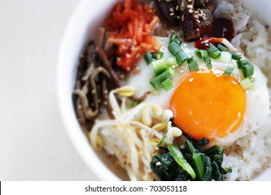 Korean food, Bibimbap vegetable and fried egg on rice with grilled beef