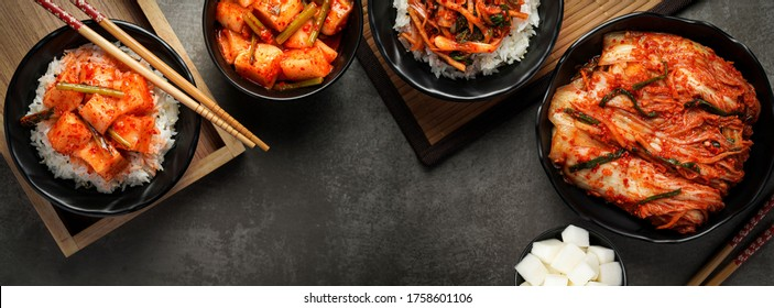 Korean food, Cabbage kimchi and Radish kimchi with rice top view set on dark background.