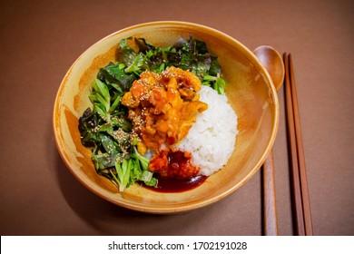 "Korean food called ""Sea Squirt Bibimbap"" boiled rice with fresh raw sea squirt(sea pineapple), vegetables(lettuce, sedum)and sauce."