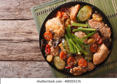 Korean food jjimdak: Stewed chicken with vegetables on a plate. horizontal view from above