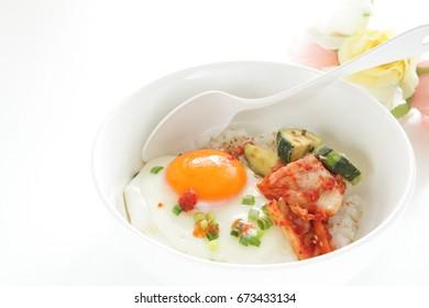 Korean food, kimchi and sunny side up fried egg