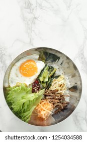 Korean food, marinated vegetable Namul and rice Bibimbap with sunny side up fried egg