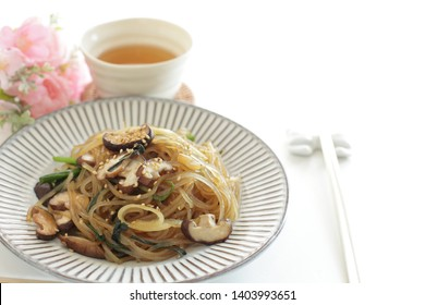 Korean food, mushroom and leek stir fried with glass noodles Vegan japchae