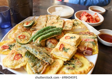 Korean food named is Pajeon that made from a batter of eggs, wheat flour, rice flour, scallions, and often other ingredients depending on the variety kimchi and other seafood are mostly used.