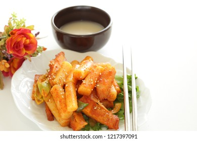 Korean food, rice cake stick and chilli sauce simmered and Makgeolli