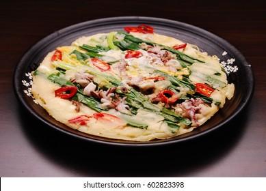 Korean Food - seafood pancake , haemul pajeon, Welsh onion, green onion, scallion, spring onion, Â  jeon, pan-fried, vegetable pancake , seafood, fish, meat, beef, pork, Korea style Pancake,