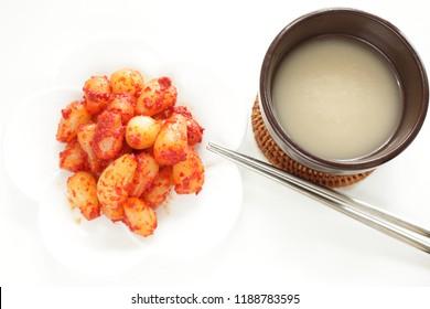Korean food, shallot kimchi and wine Makgeolli