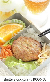Korean food, tofu patty and Namul on rice packed lunch with tea