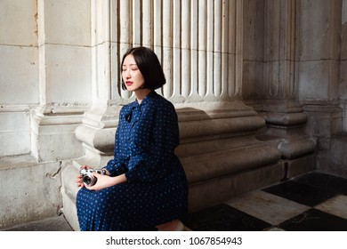 Korean Girl In Blue Dress Holding A Film Camera Stock Photo And Image Collection By Jindra Bucan Shutterstock