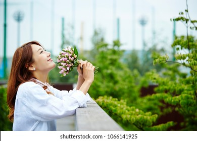 Korean girl holding flower bouquet