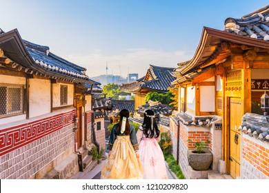 Korean Girls dressed Hanbok at Bukchon Hanok Village in Seoul, South Korea.