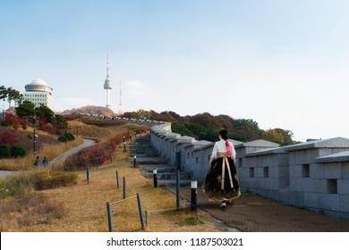 Korean Girls dressed Hanbok in traditional dress walking at Namsan mountain near N Seoul Tower in Seoul, South Korea