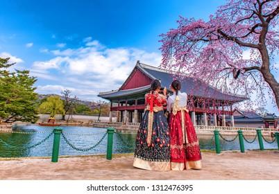Korean girls dressed hanbok in traditional dress at gyeongbokgung palace in seoul south Korea