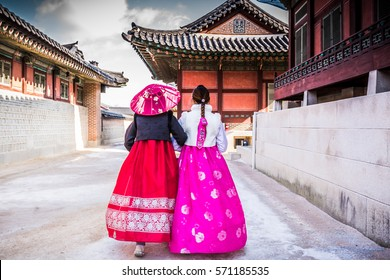 Korean Girls dressed Hanbok in traditional dress of south korea walking in Gyeongbokgung Palace, Seoul, South Korea.