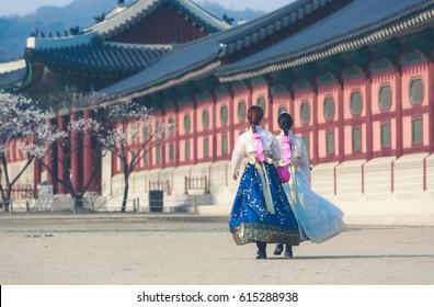 Korean Girls dressed Hanbok in traditional dress walking in Gyeongbokgung Palace, Seoul, South Korea