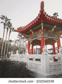 Korean Hanok building featuring palm trees in Southern California
