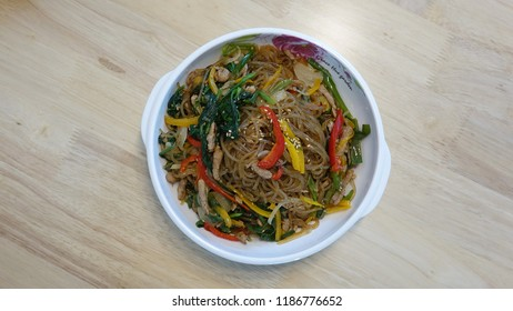 the Korean holiday of Chuseok,    the Korean holiday of Chuseok. Each dish is named Songpyeon, buchimgae, and japchae.
