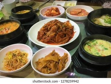Korean homemade meals. Pork bulgogi, steamed eggs, soft tofu stew, bean paste stew, etc.