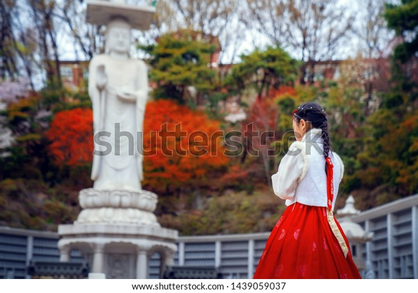 Korean lady in Hanbok dress in Bongeunsa temple  in Gangnam, Seoul city, South Korea. this image can use for travel in Korea and red autumn concept