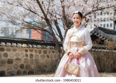 Korean lady in hanbok dress costume smile in an ancient Gyeongbokgung palace in Seoul city, South Korea, this image can use for travel, and tourist Seoul.