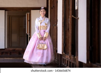 Korean lady in Hanbok or Korea gress and walk in an ancient town and Gyeongbokgung Palace in seoul, Seoul city, South Korea.