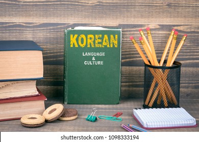 Korean language and culture concept. Book on a wooden background