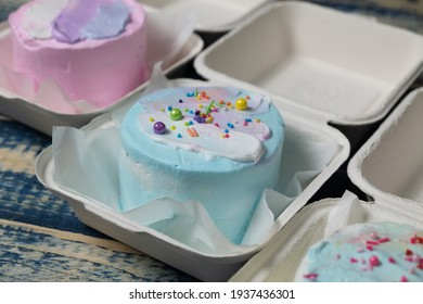 Korean lunch box cake with pastel color decoration. Selective focus.