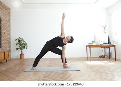 Korean man doing yoga