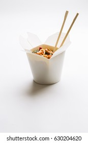 Korean noodles in cardboard box on isolated background