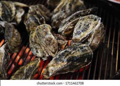 Korean oyster roasting on charcoal fire