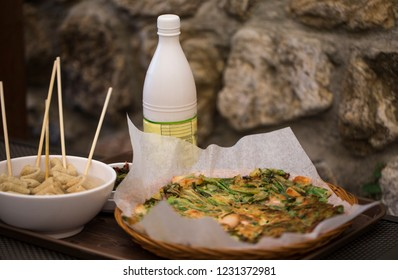 Korean pancake it call PAJEON made from vegetable and seafood.