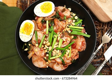 Korean Rice Cake Meal with shiitake mushrooms, soft boiled eggs, plums and yu choy. Garnished with roasted peanuts and garlic chives.