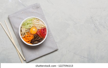 Korean rice dish Bibimbap. Usually served as a bowl of warm white rice topped with vegetables and egg. Top view