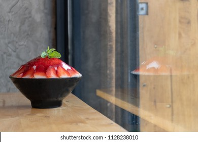 Korean shaved ice dessert with sweet toppings, Strawberry Bingsoo or Bingsu with soft focus, using as a background or wallpaper