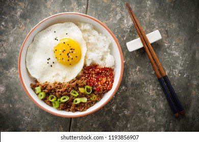 Korean Soy Beef Bowl - rice dish with rice, soy meat and chili sauce