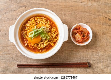 korean spicy instant noodles with egg, vegetable and kimchi - korean food style