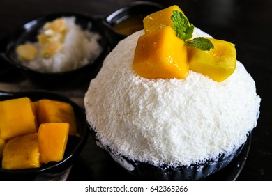 Korean style ice cream, Bing su, with chopped mangoes,sticky rice and peper mint leaves on top.